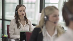 Caucasian Woman Works in a Attractive Modern Call Center (2 of 4) - stock footage