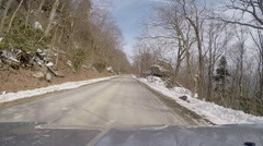 Winding mountain road winter snow Stock Footage