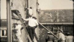 1781 - workers assemble tilt up concrete walls - vintage film home movie Stock Footage