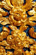 Flower  in  gold    temple    bangkok  thailand incision of the temple Stock Photos