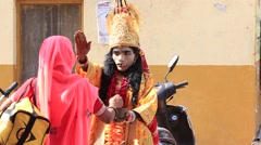 Indian sadhu in mythological clothing blesses the people on the street. Pushkar Stock Footage