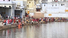 Indian people at ritual washing in the sacred Sarovar lake. Pushkar Stock Footage