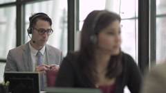 A Caucasian Man in a Suit Works in a Attractive Modern Call Center (1 of 4) - stock footage