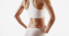 Healthy woman fitness trainer standing white background Stock Footage