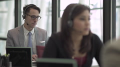 A Caucasian Man in a Suit Works in a Attractive Modern Call Center (4 of 4) Stock Footage