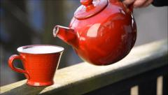 Red teapot with teacup - stock footage