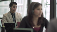Hispanic Man Works in a Attractive Modern Call Center (1 of 4) - stock footage