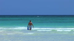 LUCAYAN BEACH/GRAND BAHAMA : Man in sea at beach Stock Footage