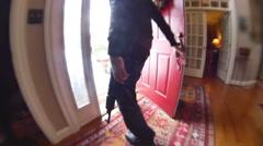 Standing at door with gun look around Stock Footage