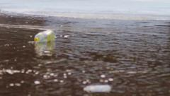 Plastic bottle floating in the mountain river - stock footage