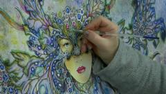 Artist painting Faery Fairy in Glastonbury Stock Footage