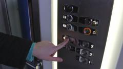 Clicking on the button in an elevator and lift movement - stock footage