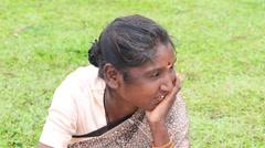 Sri Lankan beggar woman waits for alms on a street. Matara Stock Footage