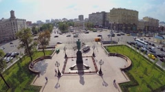Cars ride by Pushkinskaya square with monument of A.S. Pushkin Stock Footage