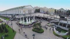 Tourists walk near fountain on Manezhnaya square Stock Footage