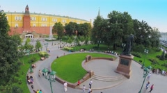 People walk near monument of Patriarch Hermogenes and Kremlin Stock Footage