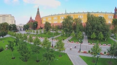 Stock Video Footage of People walk by alley and sit on grass in Aleksandrovsky garden