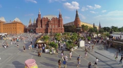 Crowd of people walk by Jam exhibition area on Manezhnaya square Stock Footage