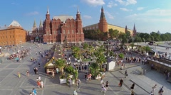 Many people walk by Preserve exhibition area on Manezhnaya square Stock Footage