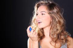 Woman taking a breath spray Stock Photos