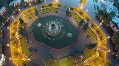 Square with Friendship of Nations fountain at summer evening Stock Footage