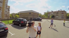 Survey squad of Moskva24 TV channel takes report at summer Stock Footage