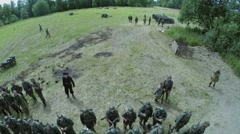 Soldiers in uniform of german army on field with armour carrier - stock footage