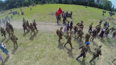 Troops in uniform of soviet army and civilians walk on road Stock Footage