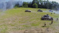 Tanks and soldiers of soviet army attack at summer day. - stock footage