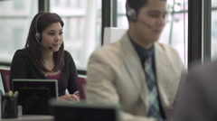 A Mixed Race Woman Works in a Attractive Modern Call Center (2 of 6) - stock footage