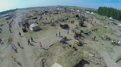 Tourists walk by military camp during reconstruction Battlefield Stock Footage