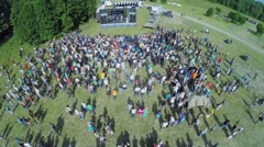 Crowd of people listen concert during reconstruction Battlefield Stock Footage