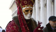 Red dress with white mask during carnival of Venice Italy Stock Footage