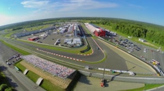 Car racing on autodrome Moscow Raceway at summer sunny day. Stock Footage