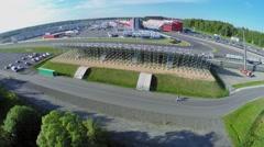 People walk near tribune on autodrome Moscow Raceway - stock footage