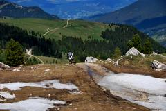 Mountain biker before departure in the mountains with snow Stock Photos