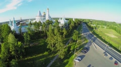 Cars ride by road near complex of New-Jerusalem Monastery Stock Footage