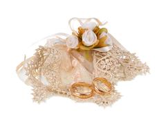 Favor with tulle and wedding rings. - stock photo