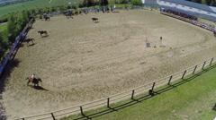 Horsemen make tricks on equestrian arena Sozidatel Stock Footage