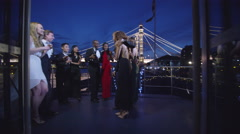 4K Attractive diverse group of friends socialising at elegant party on a boat Stock Footage