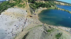 Crowd of people get rest on sand beach near lake Stock Footage