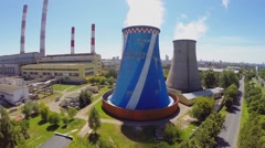 Birds fly above power plant at sunny summer day. Aerial view Stock Footage