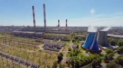 Electric power station in city at sunny summer day. Aerial view Stock Footage