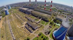 Power plant in city at sunny summer day. Aerial view Stock Footage