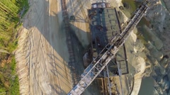 Big spoker near railroad at sandpit in sunny day. Aerial view Stock Footage