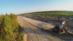 Sandpit with railway near absetzer Takraf  ERs 710 during sunset Stock Footage