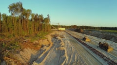 Bulldozers stand near railroad at sandpit with excavator Stock Footage