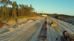 Sandpit with excavator and bulldozers near railroad Stock Footage