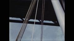 Ship Mast Passes Under Bridge - stock footage