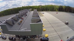 People work on roof of payment gates on toll road Stock Footage